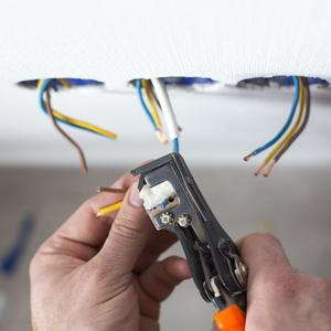 electrician wiring a socket in Cambridgeshire